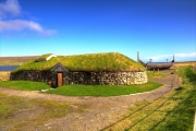 Replica Viking longhouse and longboat near Haroldswick.