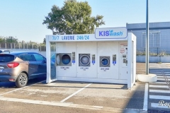 Supermarket car park laundrette, found in many places across France, Spain and increasingly in other countries.